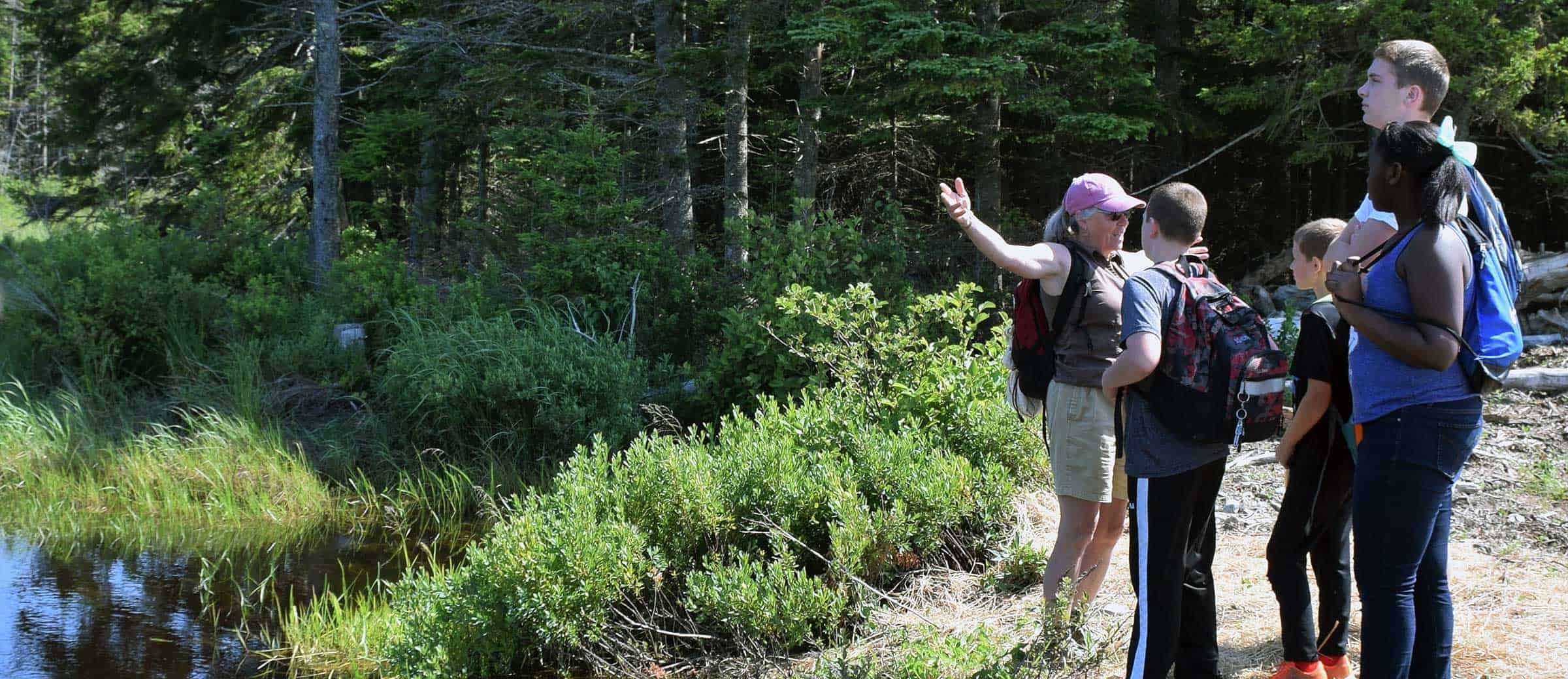 MCHT land steward Deirdre Whitehead brings local students to Long Point Preserve in Machiasport
