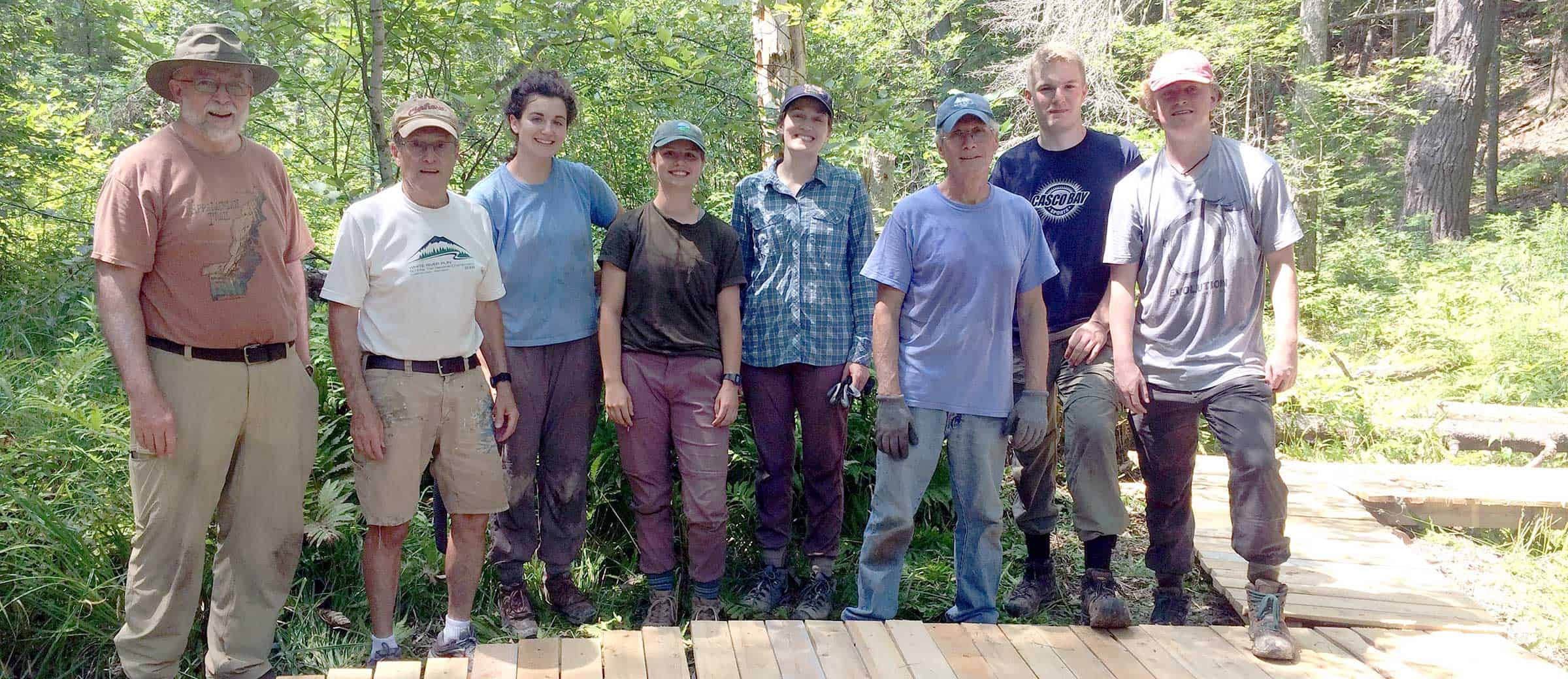 Ryan works with volunteers to build bog bridges at Red Rose Preserve (set to open in the fall of 2019).