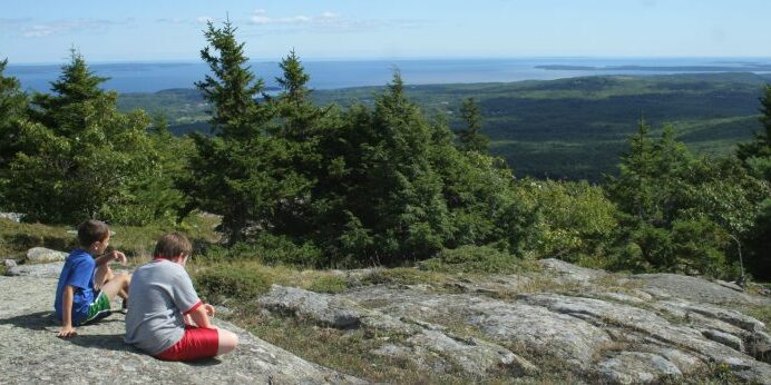 Hikers enjoy the summit of Bald Mountain in Camden.